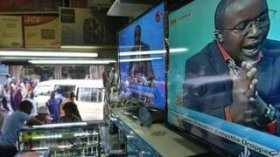A televised discussion on charges experienced by Kenyan President Uhuru Kenyatta during the Hague-based Global Criminal Court (ICC) becoming fallen, is broadcast on tv sets displayed in an electronics shop, on 5 December 2014, in Kenyan capital Nairobi